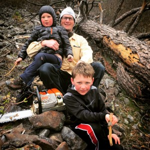 Father and his sons clearing a down tree from windstorm 2015